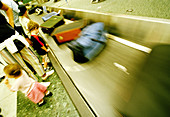 Adult, Adults, Airport, Airports, Baggage, Baggage claim, Blurred, Child, Children, Color, Colour, Contemporary, Families, Family, Horizontal, Human, Indoor, Indoors, Infant, Infants, Inside, Interior, Kid, Kids, Luggage, Motion, Movement, Moving, People