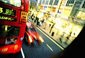Activity, Blurred, Bus, Buses, Busses, Cities, City, Coach, Coaches, Color, Colour, Daytime, Double-decker bus, England, Europe, Exterior, Great Britain, Horizontal, London, Motion, Movement, Moving, Outdoor, Outdoors, Outside, Oxford Street, Public tran
