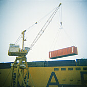 Cargo container, Cargo containers, Color, Colour, Commerce, Container ship, Container ships, Containership, Containerships, Crane, Cranes, Daytime, Dock, Docks, Economy, Export, Exports, Exterior, Harbor, Harbors, Harbour, Harbours, Industrial, Industry,