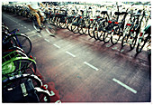Adult, Adults, Bicycle, Bicycles, Bicyclist, Bicyclists, Bike, Biker, Bikers, Bikes, Biking, Blurred, Color, Colour, Contemporary, Cycle, Cycles, Daytime, Exterior, Horizontal, Human, Lined up, Lined-up, Many, Medium-shot, Motion, Movement, Moving, One,