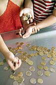Anonymous, Boy, Boys, Cash, Caucasian, Caucasians, Child, Childhood, Children, Coin, Coins, Color, Colour, Contemporary, Count, Counting, Counts, Economy, Female, Girl, Girls, Glass, Hand, Hands, Human, Indoor, Indoors, Infantile, Inside, Interior, Kid,