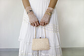 Adult, Adults, Bag, Bags, Bride, Brides, Color, Colour, Contemporary, Dress, Dresses, Female, Hand, Handbag, Handbags, Hands, Hold, Holding, Human, Indoor, Indoors, Interior, Marriage, Matrimony, One, One person, People, Person, Persons, Purse, Purses, S