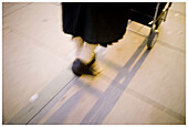 Adult, Adults, Aged, Anonymous, Blurred, Color, Colour, Contemporary, Daytime, Detail, Details, Elderly, Exterior, Feet, Female, Foot, Ground, Grounds, Human, Mature adult, Mature adults, Mature people, Motion, Movement, Moving, One, One person, Outdoor,