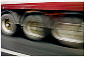 Asphalt, Blurred, Color, Colour, Concept, Concepts, Daytime, Detail, Details, Exterior, Freight transportation, Highway, Highways, Industrial, Industry, Lorries, Lorry, Motion, Movement, Moving, Outdoor, Outdoors, Outside, Road, Roads, Shipping, Thorough