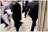 Adult, Adults, Blurred, Business, Businessman, Businessmen, Businesspeople, Businessperson, Color, Colour, Contemporary, Corporate, Daytime, Determination, Economy, Entrepreneur, Entrepreneurs, Executive, Executives, Exterior, Human, Hurry, Individualism