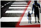 Asphalt, Caution, Child, Children, Collage, Collages, Color, Colour, Concept, Concepts, Cross, Crossing, Crosswalk, Crosswalks, Danger, Exterior, Hand holding, Hand-holding, Hazard, Hold hands, Holding hands, Kid, Kids, Montage, Montages, Outdoor, Outdoo