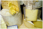 Aliment, Aliments, Cheese, Close up, Close-up, Closeup, Color, Colour, Commerce, Dairy produce, Dairy product, Different, Food, Foodstuff, For sale, Gastronomy, Heap, Heaped, Indoor, Indoors, Interior, Market, Markets, Nourishment, Piece, Pieces, Pile, P