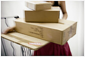 Activity, Adult, Adults, Blurred, Box, Boxes, Cardboard, Carry, Carrying, Color, Colour, Heap, Heaped, Human, Indoor, Indoors, Interior, Move home, Moving home, One, One person, Package, Packages, Parcel, Parcels, Pasteboard, People, Person, Persons, Pil