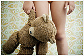 Child, Childhood, Children, Color, Colour, Contemporary, Female, Girl, Girls, Hang, Hanging, Hold, Holding, Human, Indoor, Indoors, Infantile, Interior, Kids, Leg, Legs, One, One person, People, Person, Persons, Single person, Stand, Standing, Teddy bear