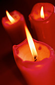Candle, Candles, Close up, Close-up, Closeup, Color, Colour, Concept, Concepts, Detail, Details, Energy, Faith, Fire, Flame, Flames, Heat, Indoor, Indoors, Interior, Light, Lit, Power, Red, Religion, Spiritual, Spirituality, Still life, Symbol, Symbols,