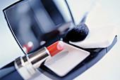 Beauty, Beauty Care, Brush, Brushes, Close up, Close-up, Closeup, Color, Colour, Concept, Concepts, Cosmetic, Cosmetics, Feminine, Handbag mirror, Horizontal, Indoor, Indoors, Interior, Lipstick, Make up, Make-up, Make-up brush, Makeup, Mirror, Mirrors,