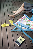 Adult, Adults, Anonymous, At home, Barefeet, Barefoot, Beach chair, Beach chairs, Book, Books, Calm, Calmness, Chill out, Chilling out, Color, Colour, Contemporary, Daytime, Deck chair, Deck chairs, Deckchair, Exterior, Feet, Female, Foot, From above, Hol