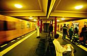 Urban railway station, blurred train leaving. Berlin. Germany