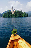 Going to the church of vows. Bled lake. Julian Alps. Slovenia