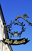 Antique wrought iron sign. Cafe Mozart. Getreidegasse pedestrian street. Salzburg. Austria
