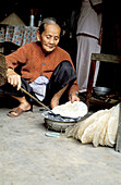 Woman baking traditional rice bread. Hoi An. Vietnam