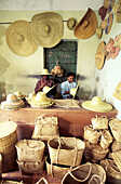 Husband and wife basket makers in their basket shop and workshop. Rodrigues Island. Mauritius