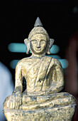 Antique bronze Buddha statuette for sale. Chatuchak Sunday Market. Bangkok. Thailand
