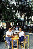 Two men chatting at outdoor cafe. Hania, Crete. Greece