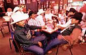 Men having a drink at Billy Bob s frontier bar. Stockyards, Fort Worth. Texas, USA