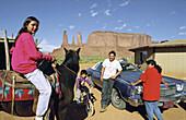 Navajo family at Monument Valley. Utah. USA