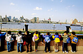 Children looking at the river in Pudong. Shanghai. China