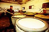 Rice wine and alcohol distillery. Rice vats. Wushen. Zhejiang province, China