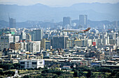 Overview on the city skyline and plane landing. Taipei. Taiwan
