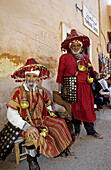 Jemaa El-Fna square water sellers in their traditional colourful costume. Marrakech. Morocco.