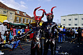 The Jab-Jabs likely lads who disguise into kind of black devils with horns and the body covered with waste motor oil.Mardi-Gras parade and preparation. Carnival. Grenada island. Caribbean