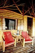 Hut in local materials for wealthy visitors playing Robinson Crusoe on a remote islet. Kia Ora luxury hotel. Rangiroa atoll. Tuamotus archipelago. French Polynesia