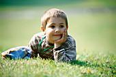 Garden, Gardens, Grass, Grin, Grinning, Horizontal, Human, Innocence, Innocent, Kid, Kids, Lawn, Lea