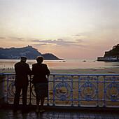 Elderly couple looking to San Sebastian Bay. Guipuzcoa, Basque Country, Spain