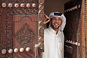 Anouar Jalil Slalouibi, by a XVIIIc. door at the Sheik bin Ali House at Muharraq. Manama. Bahrain