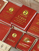 Mao Ze Dong s little red books at antiques market. Beijing, China