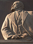 Moscow, Russia, stone carvings of Lenin on building exteriors.