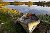Boat at a lake near Floetningen in Dalarna in the first morning light, middle Sweden