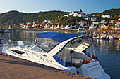 Yacht at the harbour of Moelle and view to the town, Skane, southern Sweden