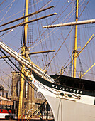 Tall ships and Brooklyn Bridge. South Street Seaport Museum. East River, New York City. USA