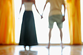 Adult, Adults, Anonymous, Back view, Color, Colour, Contemporary, Couple, Couples, Female, Hand holding, Hand-holding, Hold hands, Holding hands, Horizontal, Human, Indoor, Indoors, Inside, Interior, Male, Man, Men, New home, Pair, People, Person, Person