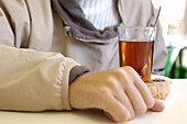 Adult, Adults, Beverage, Beverages, Close up, Close-up, Closeup, Color, Colour, Contemporary, Detail, Details, Drink, Drinks, Glass, Glasses, Hand, Hands, Health, Healthy, Herbal infusion, Horizontal, Human, Indoor, Indoors, Inside, Interior, One, One pe