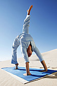 Adult, Adults, Beach, Beaches, Blue, Blue sky, Body, Calisthenics, Callisthenics, Caucasian, Caucasians, Color, Colour, Concentrate, Concentrating, Concentration, Dance, Day, Daylight, Daytime, Difficult, Dune, Effort, Efforts, Exercise, Exercises, Exter