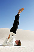 Adult, Adults, Balance, Beach, Beaches, Black, Blonde, Blue, Blue sky, Body, Calisthenics, Callisthenics, Caucasian, Caucasians, Color, Colour, Concentrate, Concentrating, Concentration, Day, Daylight, Daytime, Difficult, Dune, Effort, Efforts, Equilibri
