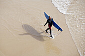 A Surfer enjoys the beach at Aftas Imsouane in the provine oof Agadir, Morocco, Africa