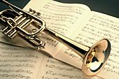 Art, Arts, Brass, Close up, Close-up, Closeup, Color, Colour, Concept, Concepts, Horizontal, Indoor, Indoors, Interior, Metal, Music, Musical instrument, Musical instruments, Object, Objects, One, One item, Score, Scores, Still life, Thing, Things, Trump