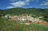 The village of Almonaster La Real in the Sierra de Aracena, which is part of the vast Sierra Morena mountain range; in spring. Province of Huelva, Andalucía, Spain.