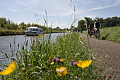 Wildflowers and Houseboat, Crown Blue Line Calypso Houseboat, near Etang de Gondrexange Lake, Alsace, France