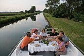 Friends Enjoying Dinner on Houseboat Deck, Crown Blue Line Calypso Houseboat, Canal du Rhone au Rhin, near Eschau, Alsace, France