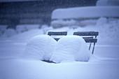 Snow on seats, Bryant Park, Midtown, Manhattan, New York, USA