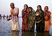 Pilgrims bathing at Sangam (the intersection of Yamuna River and Ganges River) during Kumbh Mela festival, Allahabad. Uttar Pradesh, India